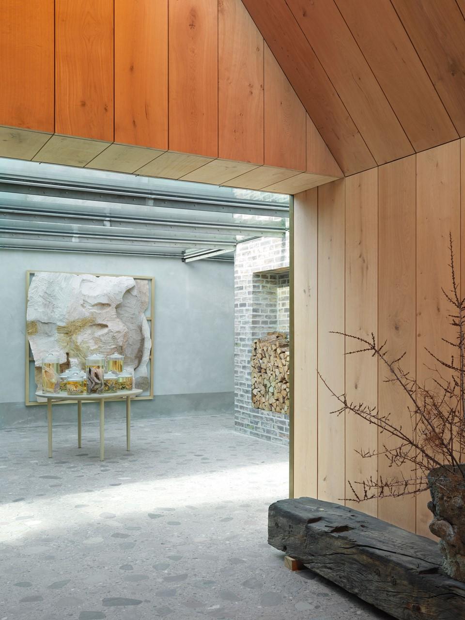 oak natural wall cladding ceiling noma entrance dinesen.jpg
